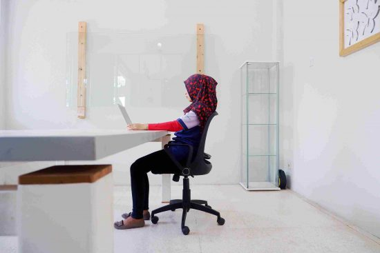 the ergonomic position of sitting down